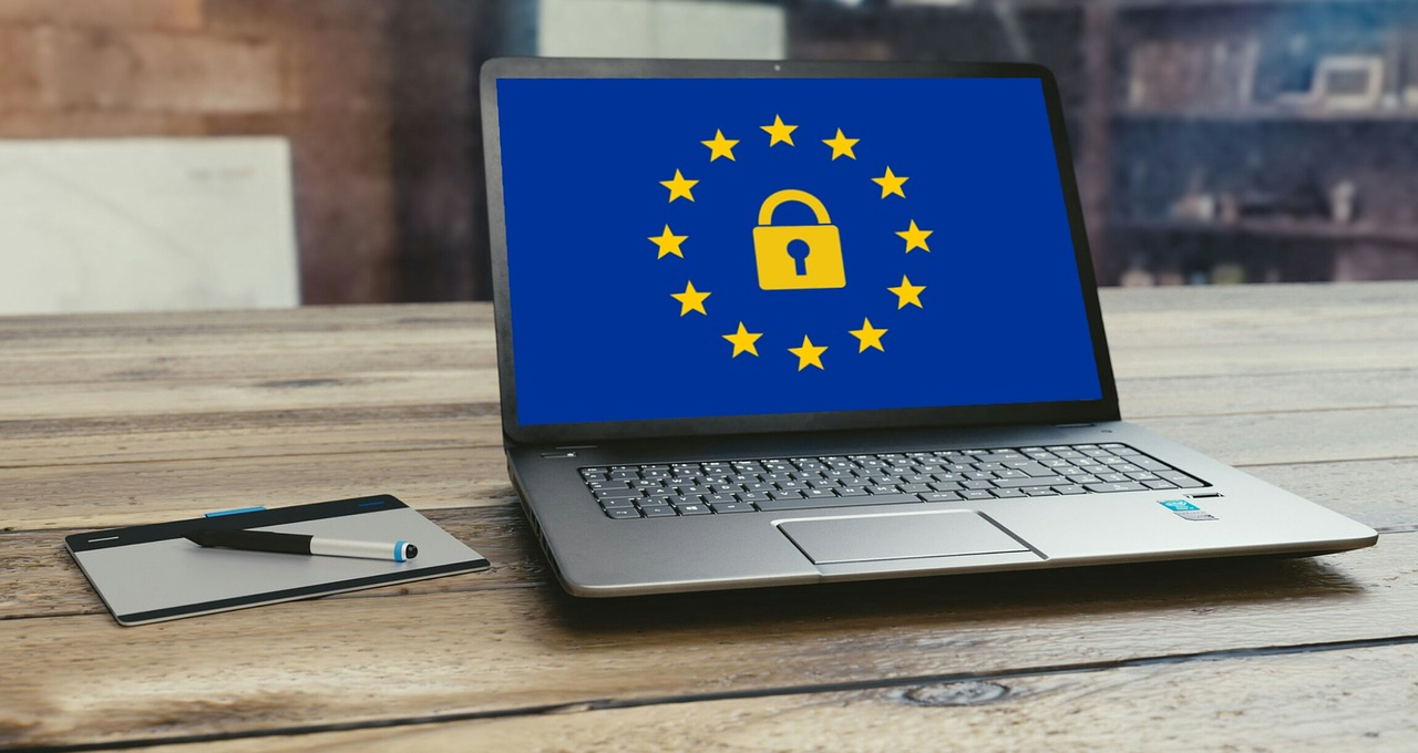 a laptop with an eu GDPR logo on the screen. Demostrating data privacy compliance